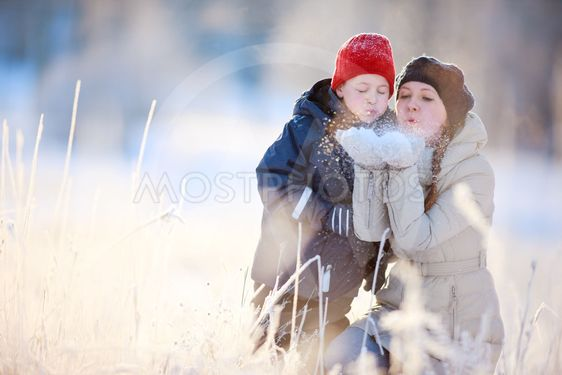 Mother and son outdoors at winter