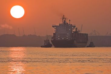 Red sunrise in the mist with ships