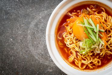 korean spicy instant noodles with egg, vegetable and kimchi