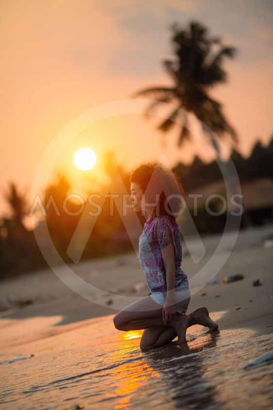 Young mixed race woman on a tropical beach during amazing...