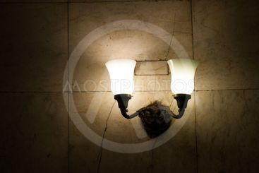 The design element is a lamp with two horns in the...