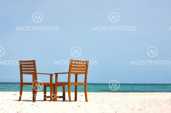 Chairs on the shore view
