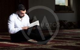 Attractive Muslim Guy Reading The Koran