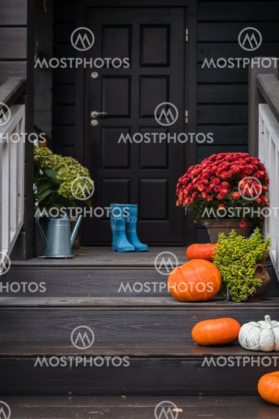 Traditional style porch, front steps decoration at...