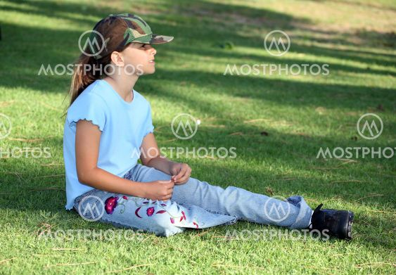 Player relaxing on grass