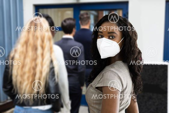 Waiting In Queue Wearing Mask