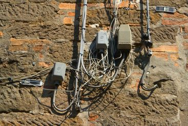 Cabling on a house wall in Italy
