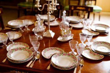 Festive table setting with plates, spoons, knives,...