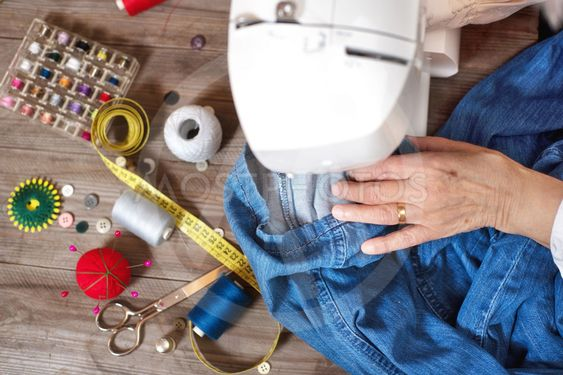 Close-up top view, of senior woman hands seamstress...