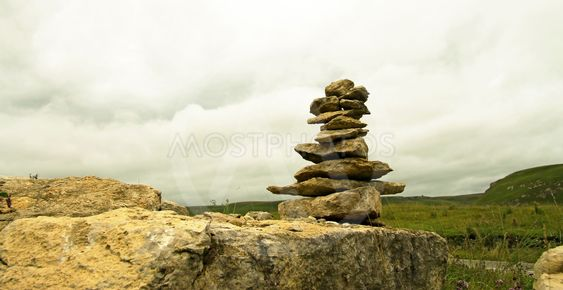 Balanced stones on the alpine meadow near caucasus...