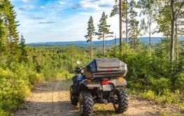 Quad / ATV on a dirt road somewhere in a Swedish forest