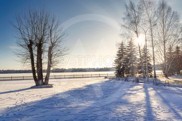 Winter landscape first snow on the embankment of the...