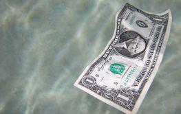 Single dollar bill floating