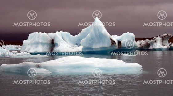 icebergs with purple sky