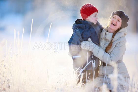Mother and son outdoors on a winter day