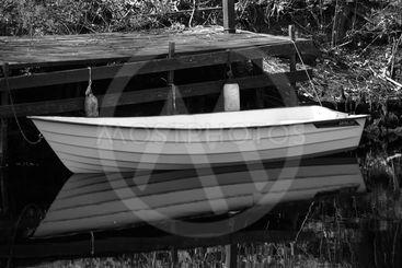 Boat by bridge