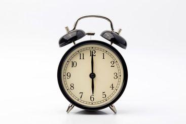 alarm clock shows six o'clock