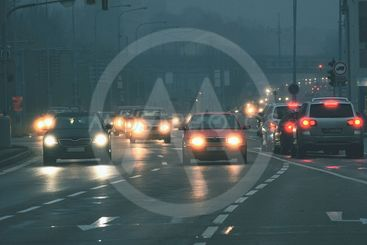 Cars in the fog. Bad winter weather and dangerous...
