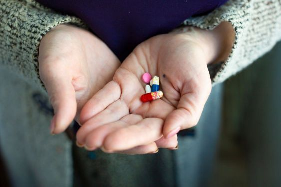 Drugs in old woman's hands. Close up photo. Lifestyle...