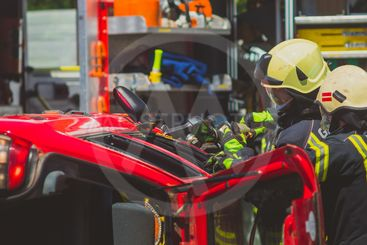 Firefighters using a hydraulic jaws of life