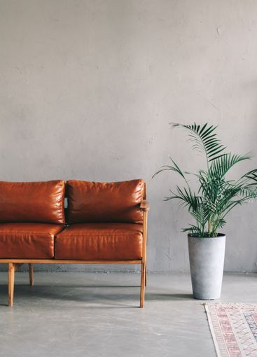 Interior detail of modern living room with brown leather...