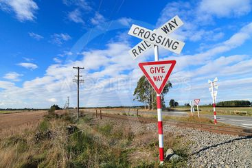 Railway crossing and give way sign.