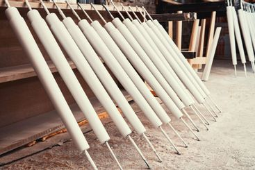 Set of wooden furniture legs drying after applying paint