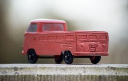 Rear view of orange Volkswagen van toy miniature in...