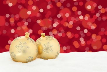 Christmas golden balls red background decoration with...