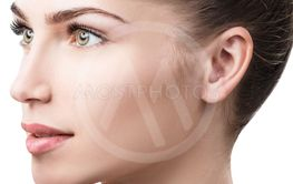 Side view on beautiful female face with perfect skin.