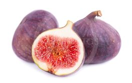 Fresh purple fig fruit isolated on white background....