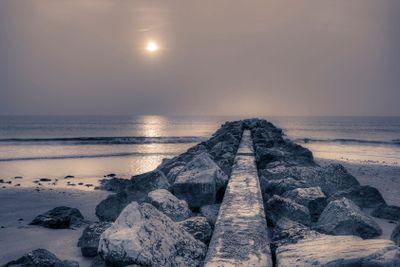 Stone pier at sunrise.