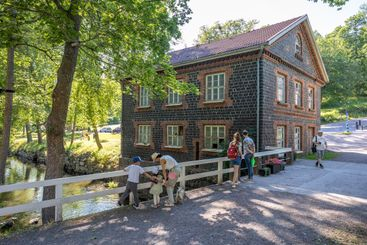 People next to the Mill in Fiskars village