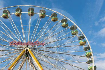 Ferris wheel against a blue sky at the Christmas fair in...