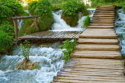 Walkway through waterfall.