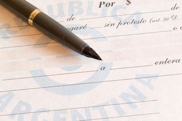 promissory note and pen