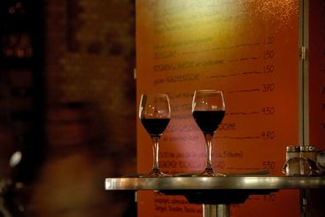 two wineglasses on a bistro table
