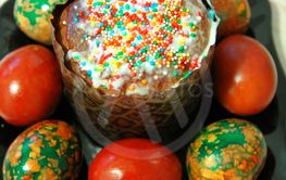 Colorful Easter Eggs On Black Plate Placed By Heap