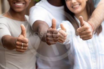 Close up diverse people showing thumbs up