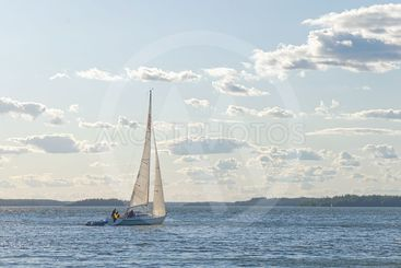 Sailboat sailing in windy sunny weather