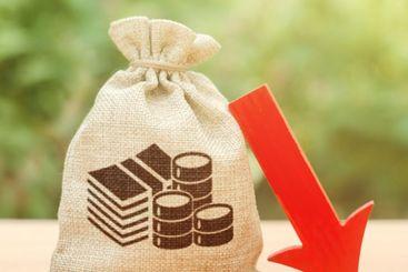 Money bag near a red arrow down. Recession of economy....