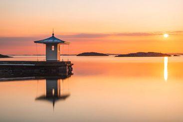 Reflection of per on idyllic sea during sunset