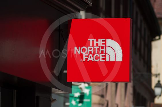 the north face logo on store front in the street
