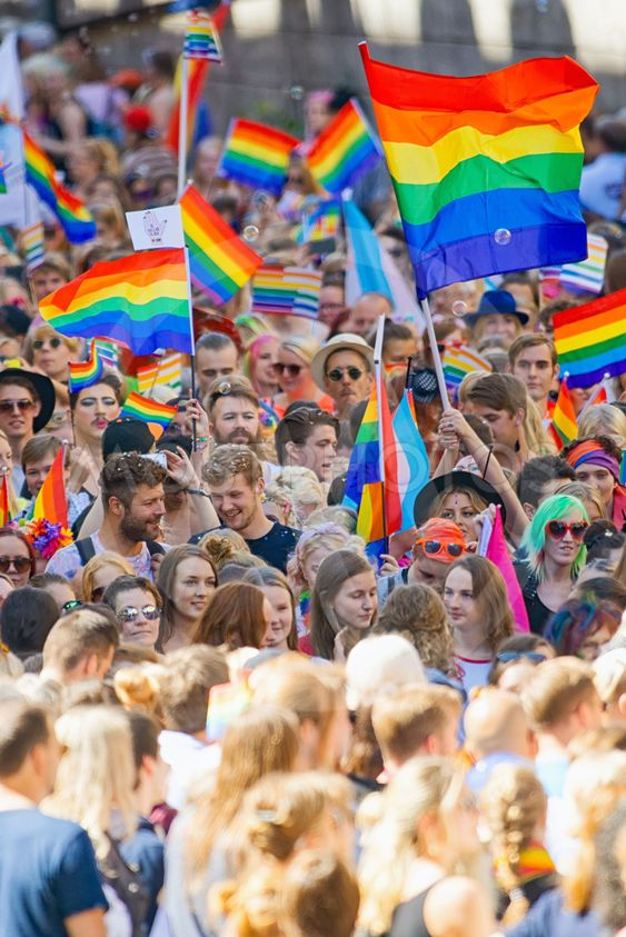 Big crowd walking with the Pride parade