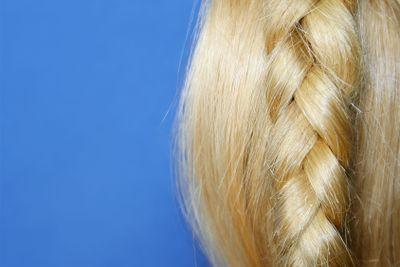 Blond hair on blue