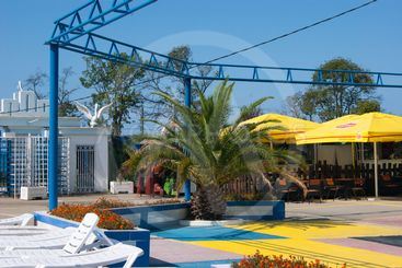 Aqualoo Waterpark - view from pools with white sunbeds...