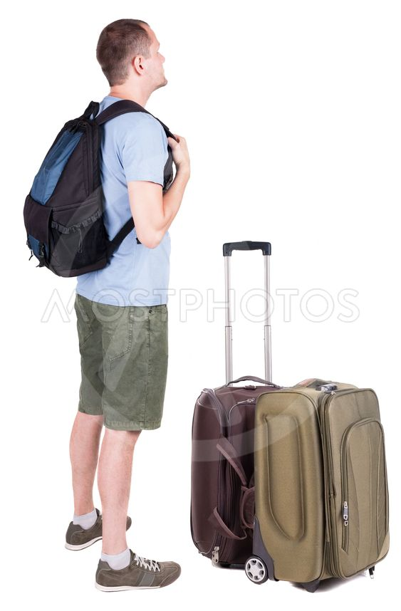 Back view of young man traveling with suitcas.