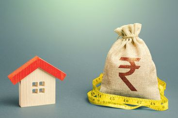House and a indian rupee money bag. Mortgage loan....