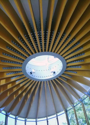Oval ceiling from metal, glass and wood