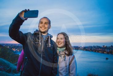 Young tourist couple taking a selfie